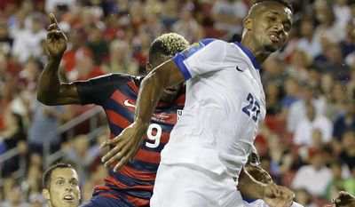 Martinique's Stephane Abaul (20) heads the ball away from United States' Gyasi Zardes (9) on a corner kick during a CONCACAF Gold Cup soccer match, Wednesday, July 12, 2017, in Tampa, Fla. (AP Photo/John Raoux)