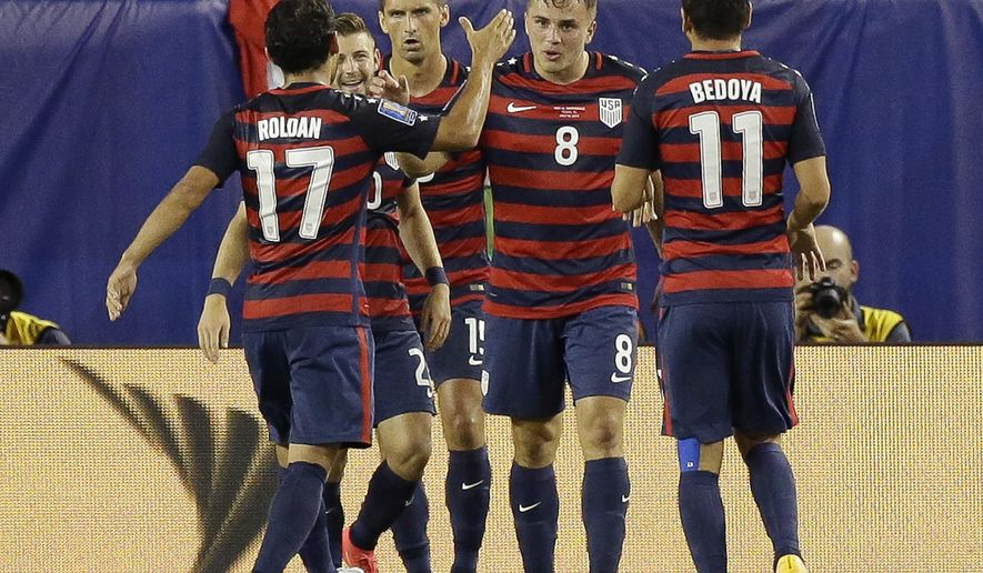 United States' Jordan Morris (8) celebrates after scoring a goal against Martinique with teammates including Cristian Roldan (17) and Alejandro Bedoya (11) during a CONCACAF Gold Cup soccer match, Wednesday, July 12, 2017, in Tampa, Fla. United States won 3-2. (AP Photo/John Raoux)