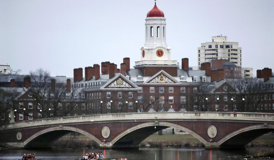 In this March 7, 2017, file photo, rowers paddle along the Charles River past the Harvard College campus in Cambridge, Mass. (AP Photo/Charles Krupa, File) **FILE**