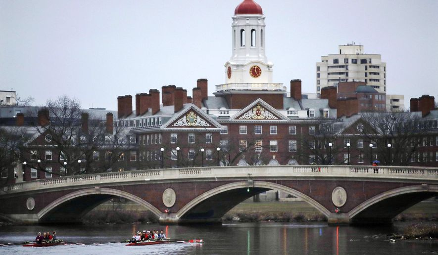In this March 7, 2017, file photo, rowers paddle along the Charles River past the Harvard College campus in Cambridge, Mass. (AP Photo/Charles Krupa, File)