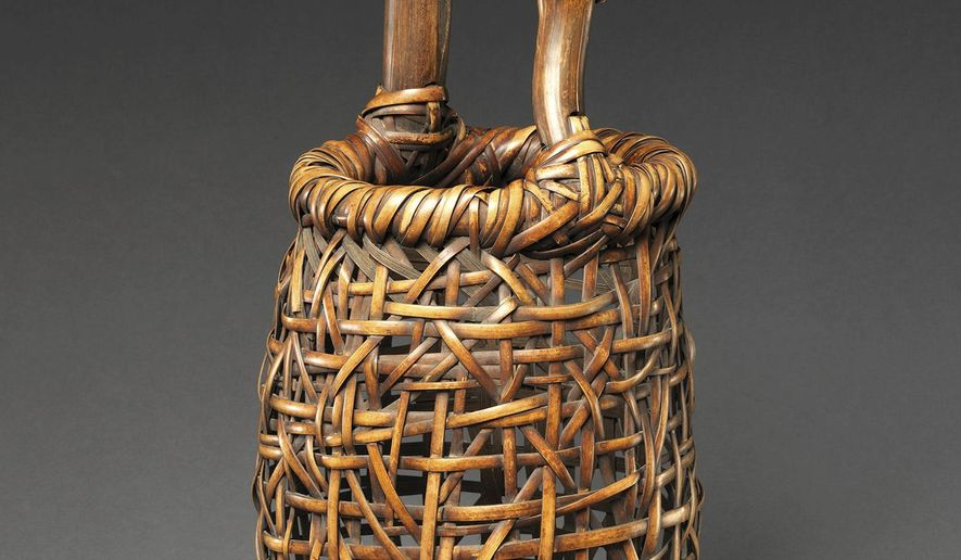 """This photo provided by The Metropolitan Museum of Arts shows """"Dancing Frog Flower Basket"""" by Hayakawa Shokosai III. The piece is part of the exhibit """"Japanese Bamboo Art: The Abbey Collection"""" at the Museum in New York which runs through Feb. 4, 2018. (The Metropolitan Museum of Art via AP)"""