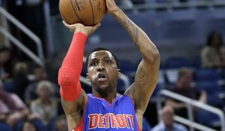 In this March 24, 2017, photo, Detroit Pistons' Kentavious Caldwell-Pope takes a shot against the Orlando Magic during the first half of an NBA basketball game in Orlando, Fla. A person with knowledge of the deal tells The Associated Press Tuesday night, July 11, 2017 that the Los Angeles Lakers have signed free agent guard Caldwell-Pope to a one-year, $18 million contract. (AP Photo/John Raoux)