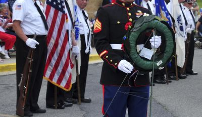 In this May 25, 2009, photo U.S. Marine Staff Sgt. William Kundrat places a wreath during a Memorial Day ceremony at the FSK Post 11, American Legion in Frederick, Md. Kundrat, 33, who grew up in Frederick, Md., was killed in a plane crash Monday, July 10, 2017, in Mississippi. (Sam Yu/The Frederick News-Post via AP)