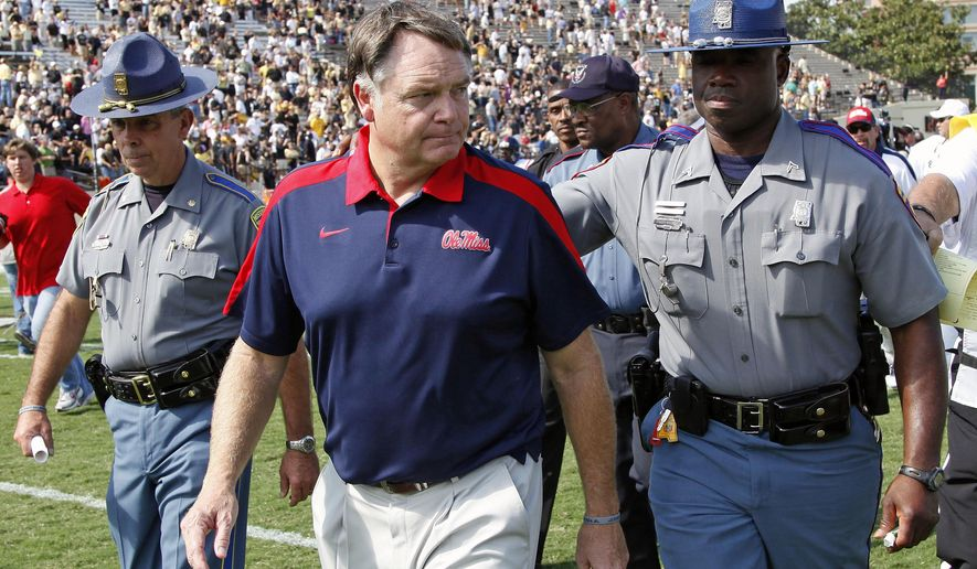 FILE - In this Sept. 17, 2011, file photo, Mississippi head coach Houston Nutt leaves the field after losing to Vanderbilt 30-7 in an NCAA college football game, in Nashville, Tenn. Former Mississippi coach Houston Nutt has filed a civil lawsuit against the university and its athletics foundation, alleging a breach of his contract because of false statements he says school officials made during an ongoing NCAA investigation.The lawsuit was filed Wednesday, July 12, 2017, in federal court in Mississippi. (AP Photo/Mark Humphrey, File)