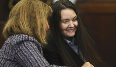 Rachelle Bond, right, smiles with defense attorney Janice Bassil before she is sentenced by Suffolk Superior Court Judge Janet L. Sanders Wednesday, July 12, 2017, for her after-the-fact involvement in the death of her 2-year-old daughter, Bella Bond was sentenced Wednesday to time served and two years of probation for her role in disposing of her daughter's body.  (Pat Greenhouse/The Boston Globe via AP, Pool)
