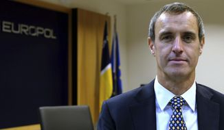 Europol director Rob Wainwright poses for a picture during an interview in The Hague, Netherlands, Friday, Dec. 2, 2016. The Islamic State group is likely to carry out new attacks in the European Union in the near future, probably targeting countries that are members of the U.S.-led coalition fighting the extremist organization in Syria and Iraq, EU police agency Europol said in a report published Friday. (AP Photo/Mike Corder)
