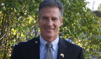 Scott Brown, the U.S. ambassador in New Zealand, poses for a photograph at the U.S. Embassy on Tuesday, July 11, 2017, in Wellington, New Zealand. Brown took up the post two weeks earlier, becoming one of the first ambassadors tapped by President Donald Trump to begin serving. (AP Photo/Nick Perry)