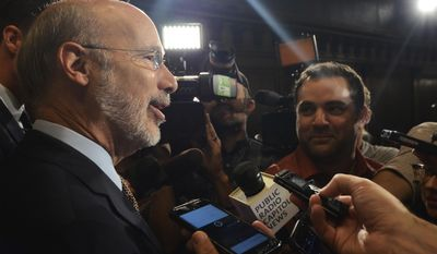 Democratic Gov. Tom Wolf speaks to reporters in his offices in his first public appearance after letting a nearly $32 billion budget bill become law without his signature, despite it's being badly out of balance after revenue talks with lawmakers collapsed, Wednesday, July 12, 2017 in Harrisburg, Pa. (AP Photo/Marc Levy)