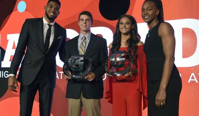 Winners MacKenzie Gore, of Whiteville High School in Whiteville, N.C., center left, and Sydney McLaughlin, of Union Catholic High School in Scotch Plains, N.J., center right, pose with NBA basketball player Karl Anthony Towns, of the Minnesota Timberwolves, left, and Tamika Catchings, right, at the 15th annual High School Athlete of the Year Awards at the Ritz-Carlton hotel on Tuesday, July 11, 2017, in Marina del Rey, Calif. (AP Photo/Chris Pizzello)