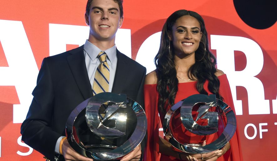 MacKenzie Gore, of Whiteville High School in Whiteville, N.C., left, and Sydney McLaughlin, of Union Catholic High School in Scotch Plains, N.J. pose with their awards at the 15th annual High School Athlete of the Year Awards at the Ritz-Carlton hotel on Tuesday, July 11, 2017, in Marina del Rey, Calif. (AP Photo/Chris Pizzello)