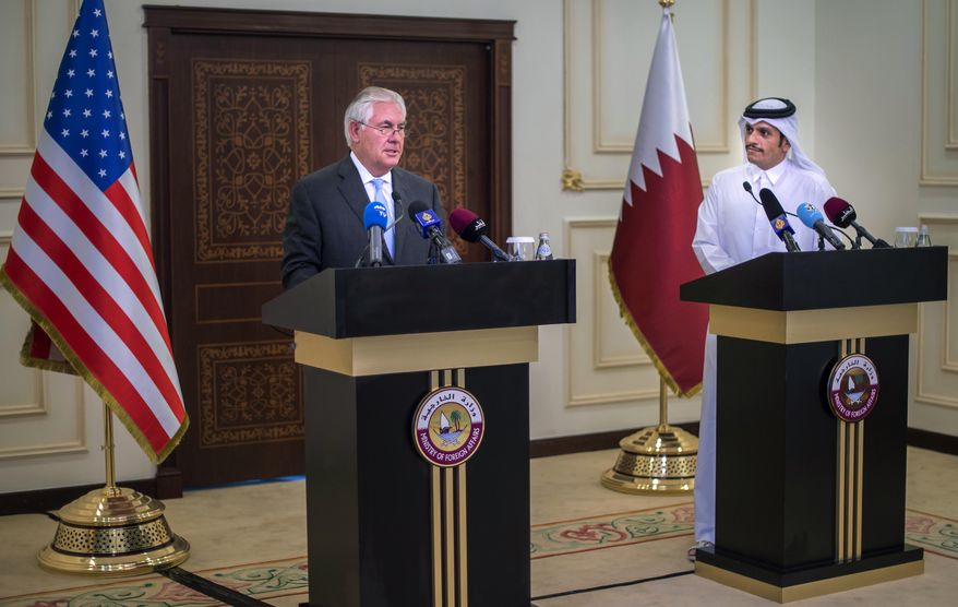 In this Tuesday July 11, 2017 photo U.S. Secretary of State Rex Tillerson, left, and the Qatari Minister of Foreign Affairs Sheikh Mohammed bin Abdulrahman Al Thani take part in a press conference in Doha, Qatar. Tillerson arrived in Qatar as he tries to mediate a dispute between the energy-rich country and its Gulf neighbours. (Alexander W. Riedel/US State Department via AP)