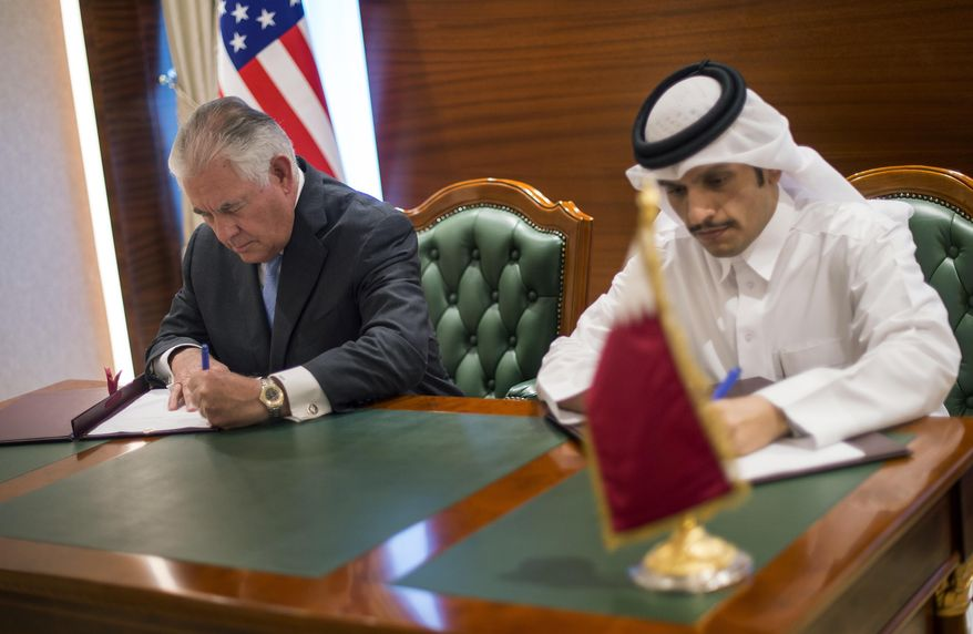 In this Tuesday July 11, 2017 photo U.S. Secretary of State Rex Tillerson, left, and the Qatari Minister of Foreign Affairs Sheikh Mohammed bin Abdulrahman Al Thani sign an memorandum of understanding  in Doha, Qatar. Tillerson arrived in Qatar as he tries to mediate a dispute between the energy-rich country and its Gulf neighbours. (Alexander W. Riedel/US State Department via AP)