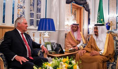 In this photo released by Saudi Press Agency, Saudi King Salman, right, receives U.S. Foreign Secretary Rex Tillerson, in Jiddah, Saudi Arabia, Wednesday, July 12, 2017. (Saudi Press Agency via AP)
