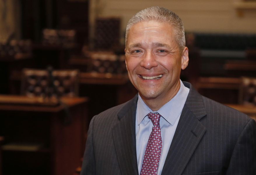 Newly-elected Oklahoma state Sen. Michael Brooks poses for a photo on the floor of the state Senate during a tour of the state Capitol in Oklahoma City, Wednesday, July 12, 2017. Brooks won his Senate seat in a special election Tuesday, July 11, 2017, held to fill the Senate district 44 seat vacated when Sen. Ralph Shortey resigned. (AP Photo/Sue Ogrocki)