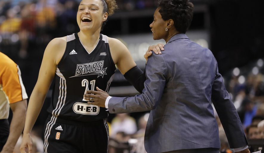 San Antonio Stars' Kayla McBride laughs with head coach Vickie Johnson during the second half of a WNBA basketball game against the Indiana Fever, Wednesday, July 12, 2017, in Indianapolis. San Antonio defeated Indiana 79-72. (AP Photo/Darron Cummings)