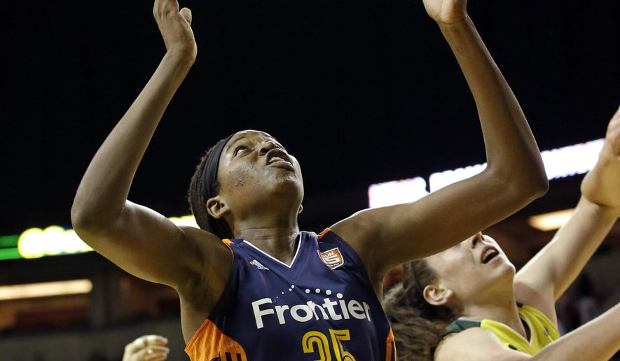 Connecticut Sun's Jonquel Jones (35) reaches for a rebound in front of Seattle Storm's Breanna Stewart in the first half of a WNBA basketball game Wednesday, July 12, 2017, in Seattle. (AP Photo/Elaine Thompson)