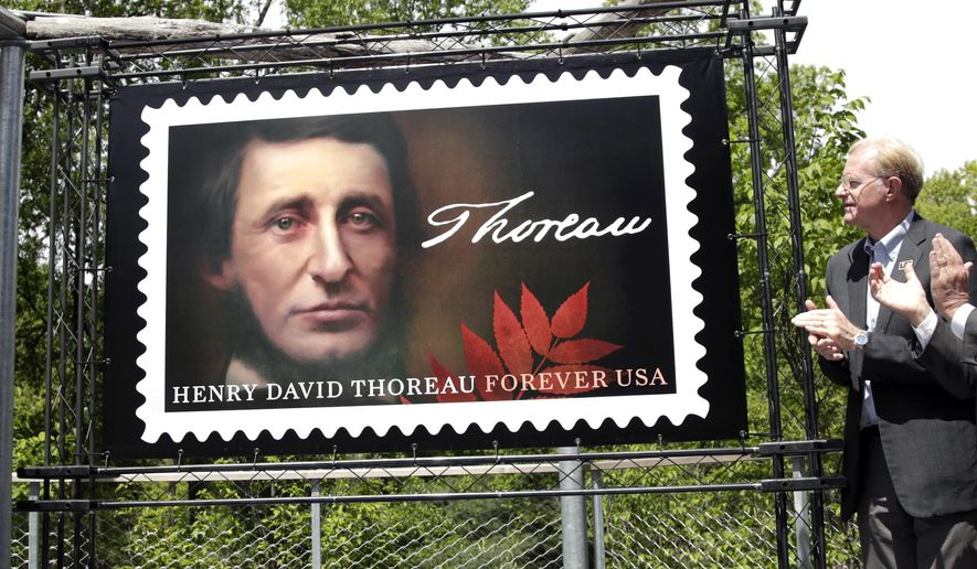 FILE- In this May 23, 2017, file photo, actor and environmentalist Ed Begley Jr., a board member of the Walden Woods Project, applauds during the dedication of the U.S. Postal Service's new Henry David Thoreau postage stamp at Walden Pond in Concord, Mass. Thoreau is being honored on the 200th anniversary of his birth. The U.S. Postal Service says it plans to hold a special dedication of the recently released stamp of the 19th century American philosopher and naturalist Wednesday, July 12, at his birthplace in Concord, Mass. (AP Photo/Elise Amendola)