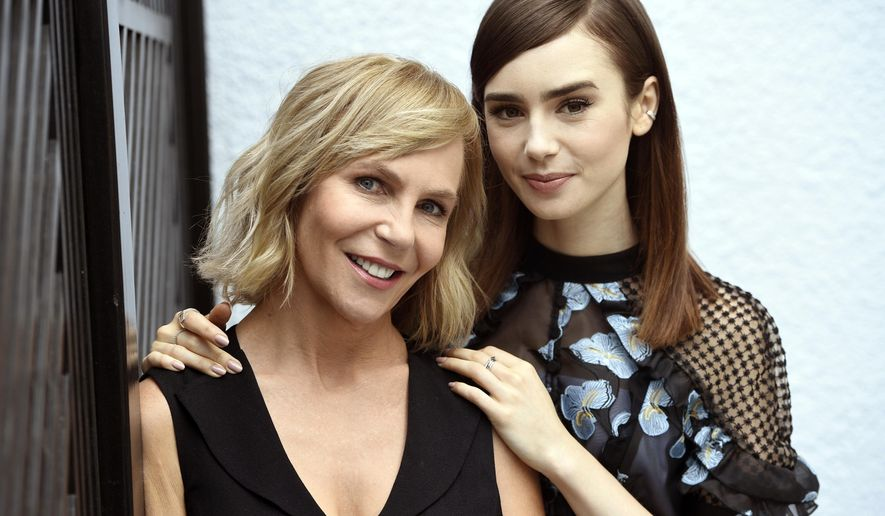 """In this June 29, 2017 photo, writer-director Marti Noxon, left, and actress Lily Collins pose at the London West Hollywood hotel to promote their film, """"To the Bone,"""" in West Hollywood, Calif. (Photo by Chris Pizzello/Invision/AP)"""