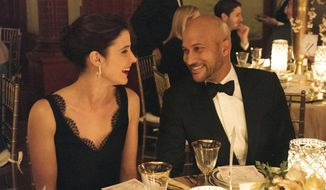 "This image released by Netflix shows Cobie Smulders, left, and Keegan-Michael Key in ""Friends From College,"" premiering Friday on Netflix. (Barbara Nitke/Netflix via AP)"