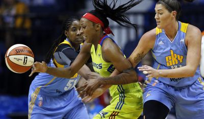 Dallas Wings forward Glory Johnson, left, controls the ball between Chicago Sky forward Jessica Brand (51), left, and forward/center Stephanie Dotson during the first half of a WNBA basketball game Wednesday, July 12, 2017, in Rosemont, Ill. (AP Photo/Nam Y. Huh)