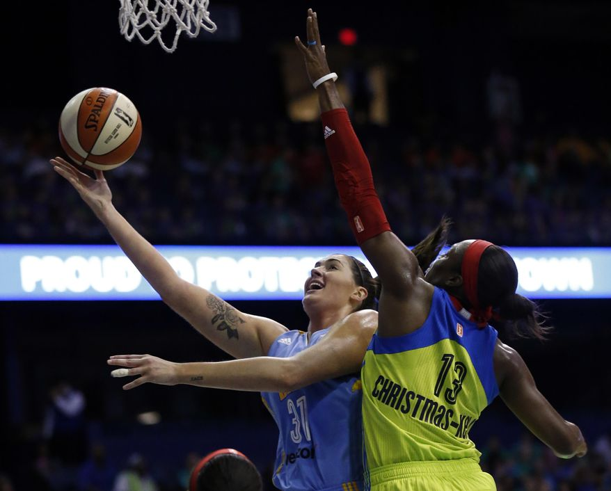 Chicago Sky forward/center Stephanie Dotson, left, shoots against Dallas Wings forward Karima Christmas-Kelly during the first half of a WNBA basketball game Wednesday, July 12, 2017, in Rosemont, Ill. (AP Photo/Nam Y. Huh)