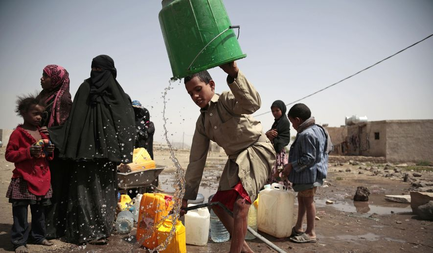 A boy rinses a bucket as he and others collect water from a well that is allegedly contaminated with cholera bacteria, on the outskirts of Sanaa, Yemen, Wednesday, July 12, 2017. The U.N. health agency said Tuesday that plans to ship cholera vaccine to Yemen are likely to be shelved over security, access and logistical challenges in the war-torn country. Yemen's suspected cholera caseload has surged past 313,000, causing over 1,700 deaths in the world's largest outbreak. (AP Photo/Hani Mohammed)