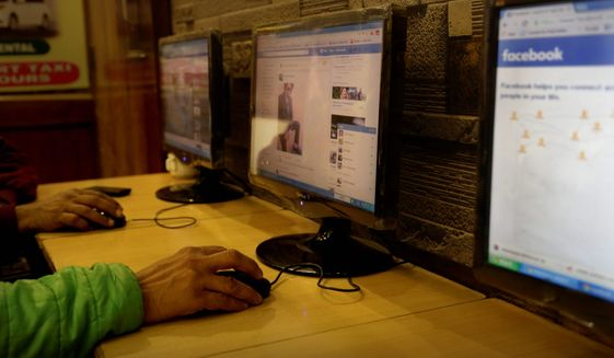 India's telecoms regulator has essentially banned a Facebook program that sought to connect with low-income residents by offering free access to a limited version of the social network and other internet services, as part of a ruling in favor of net neutrality. (Associated Press/File)