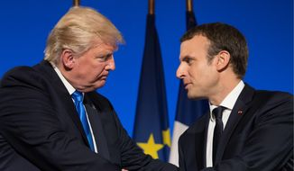 President Donald Trump and French President Emmanuel Macron shake hands at the conclusion of a joint news conference at the Elysee Palace in Paris, Thursday, July 13, 2017. (AP Photo/Carolyn Kaster)