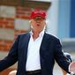 """President Trump wear his signature """"Make American Great Again"""" cap. The """"MAGA"""" idea has now been applied to the nation's economy. (Associated Press)"""