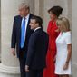 French President Emmanuel Macron and his wife, Brigitte, accompanied President Trump and first lady Melania Trump in the courtyard at the Invalides in Paris after an official welcoming ceremony on Thursday. (Associated Press)