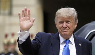 US President Donald Trump waves as he arrives for a meeting with French President Emmanuel Macron at the Elysee Palace in Paris, Thursday, July 13, 2017. Trump will be the parade's guest of honor to commemorate the 100th anniversary of the U.S. entry into World War I. U.S. troops will open the parade Friday as is traditional for the guest of honor. (AP Photo/Markus Schreiber)