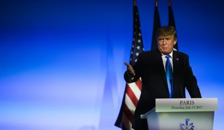 """U.S President Donald Trump gestures during a press conference with French President Emmanuel Macron at the Elysee Palace in Paris, Thursday, July 13, 2017. President Donald Trump is saluting the United States' """"unbreakable"""" bond with France. (AP Photo/Markus Schreiber)"""