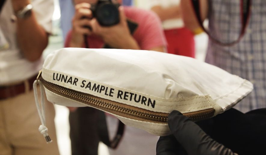 The Apollo 11 Contingency Lunar Sample Return Bag used by astronaut Neil Armstrong, to be offered at auction, is displayed at Sotheby's, in New York, Thursday, July 13, 2017. The lunar dust plus some tiny rocks that Armstrong also collected are zipped up in a small bag and are worth an estimated $2 million to $4 million.(AP Photo/Richard Drew)