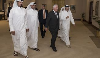 U.S. Secretary of State Rex Tillerson walks with Qatari Minister of Foreign Affairs Sheikh Mohammed bin Abdulrahman Al Thani, 1st right, after he arrives in Doha, Qatar, on July 13, 2017. (Alexander W. Riedel/State Department via AP)