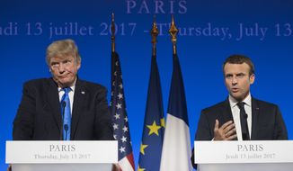 President Donald Trump and French President Emmanuel Macron participate in a joint news conference at the Elysee Palace in Paris, Thursday, July 13, 2017. (AP Photo/Carolyn Kaster)