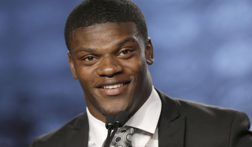Louisville's Lamar Jackson speaks to the media during the Atlantic Coast Conference NCAA college football media day in Charlotte, N.C., Thursday, July 13, 2017. (AP Photo/Chuck Burton)
