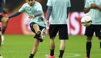 "FILE - This is a Tuesday, May 23, 2017  file photo of Ajax's Abdelhak Nouri as he kicks a ball during a training session at the Friends Arena in Stockholm, Sweden. Ajax midfielder Abdelhak Nouri who collapsed due to an irregular heartbeat during a friendly game in Austria on Saturday July 8, 2017 has suffered ""severe and permanent brain damage."" The Dutch club says ""it received very bad news regarding the condition of Abdelhak Nouri"" after doctors at a hospital in Innsbruck woke up the player from an induced coma. (AP Photo/Martin Meissner/File)"