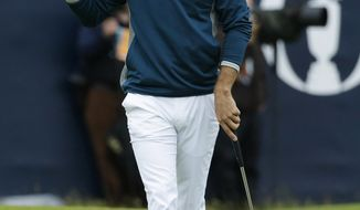 FILE - In this Friday, July 15, 2016, file photo, Dustin Johnson of the United States acknowledges the crowd as he walks off the 18th green after completing his second round of the British Open Golf Championships at the Royal Troon Golf Club in Troon, Scotland. First-timers have won the last seven majors. The British Open starts July 20, 2017, and Royal Birkdale has a history or rewarding players who already have won majors. (AP Photo/Matt Dunham, File)