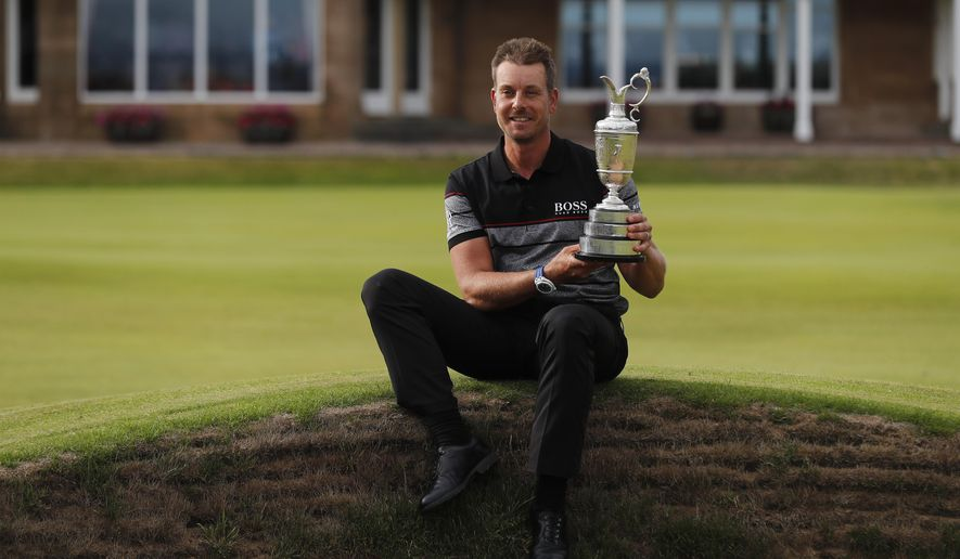 FILE - In this Sunday, July 17, 2016, file photo, Henrik Stenson of Sweden poses with the trophy after winning the British Open Golf Championships at the Royal Troon Golf Club in Troon, Scotland. First-timers have won the last seven majors. The British Open starts July 20, 2017, and Royal Birkdale has a history or rewarding players who already have won majors. (AP Photo/Ben Curtis, File)