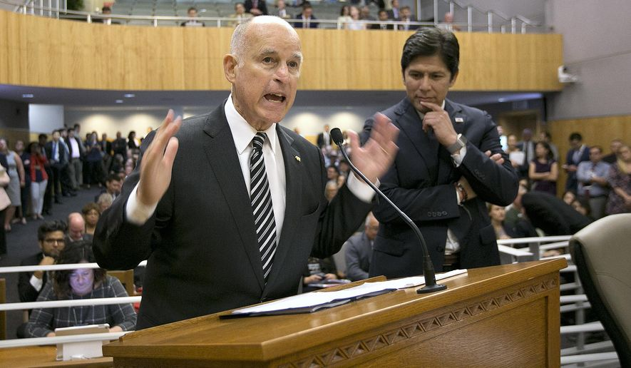 California Gov. Jerry Brown, left, flanked by Senate President Pro Tem Kevin de Leon, D-Los Angeles, urges members of the Senate Environmental Quality Committee to approve a pair of bills to extend state's cap and trade program, Thursday, July 13, 2017, in Sacramento, Calif. (AP Photo/Rich Pedroncelli)