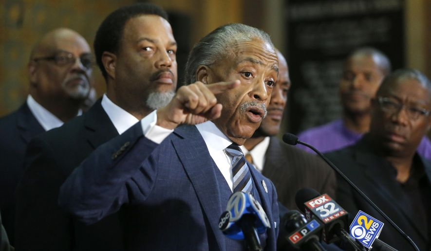 Rev. Al Sharpton, stands with area clergy and responds to a question during a news conference Thursday, July 13, 2017, in Chicago, where they voiced concerns over the announcement that more federal agents will be sent to Chicago without serious meetings with community leaders. (AP Photo/Charles Rex Arbogast)