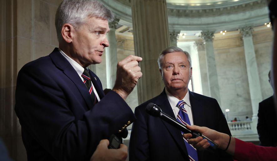 "Sen. Bill Cassidy (left), who wrote the state block grant bill with Sen. Lindsey Graham, South Carolina Republican, said the legislation is near the vote threshold to pass. ""We are thinking that we can get this done by Sept. 30,"" he said Friday. (Associated Press/File)"