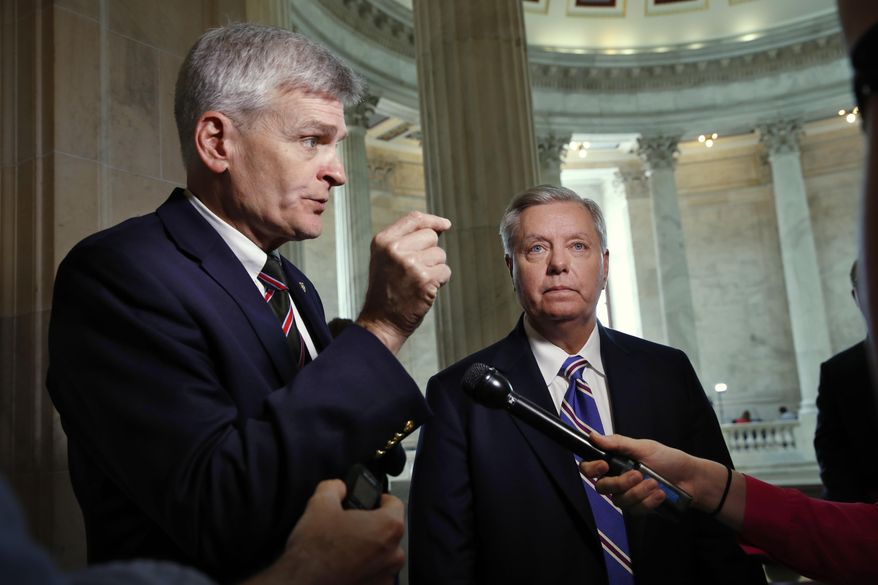 """Sen. Bill Cassidy (left), who wrote the state block grant bill with Sen. Lindsey Graham, South Carolina Republican, said the legislation is near the vote threshold to pass. """"We are thinking that we can get this done by Sept. 30,"""" he said Friday. (Associated Press/File)"""