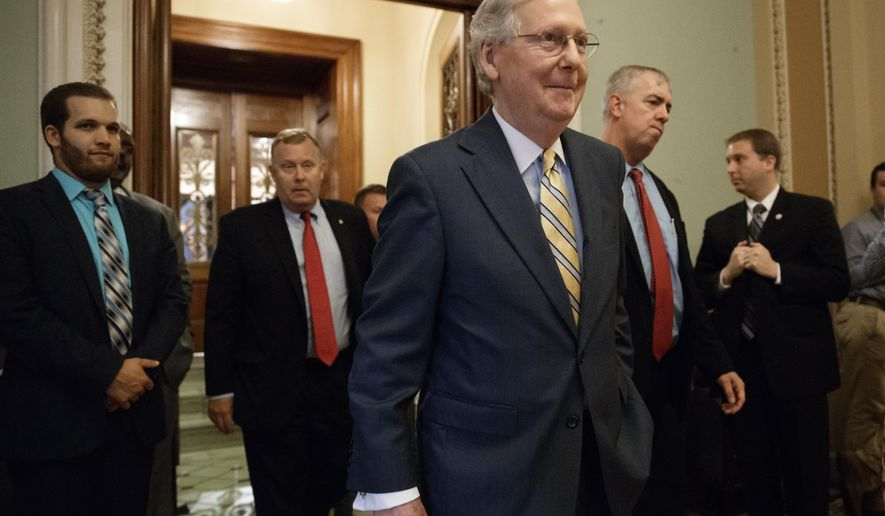 Senate Majority Leader Mitch McConnell of Ky. leaves the Senate chamber on Capitol Hill in Washington, Thursday, July 13, 2017, after announcing the revised version of the Republican health care bill. (AP Photo/J. Scott Applewhite)