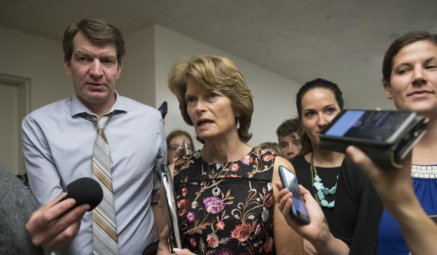 Sen. Lisa Murkowski, R-Alaska, and other lawmakers, head to the Senate on Capitol Hill in Washington, Thursday, July 13, 2017, for a meeting on the revised Republican health care bill, which has been under attack from within the party, including by Murkowski. (AP Photo/J. Scott Applewhite) ** FILE **