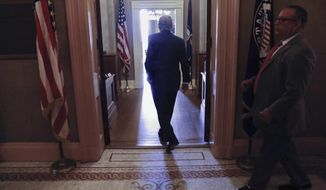 Senate Majority Leader Mitch McConnell of Ky. walks into his office on Capitol Hill in Washington Thursday, July 13, 2017. McConnell is planning on rolling out the GOP's revised health care bill, pushing toward a showdown vote next week with opposition within the Republican ranks. (AP Photo/Pablo Martinez Monsivais)