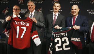 Arizona Coyotes owner Andrew Barroway, left, poses for a photograph with new team president and CEO, Steve Patterson, second from left, along with president of hockey operations John Chayka, second from right, and new coach Rick Tocchet, right, during a news conference for the NHL hockey team Thursday, July 13, 2017, in Glendale, Ariz. (AP Photo/Ross D. Franklin)