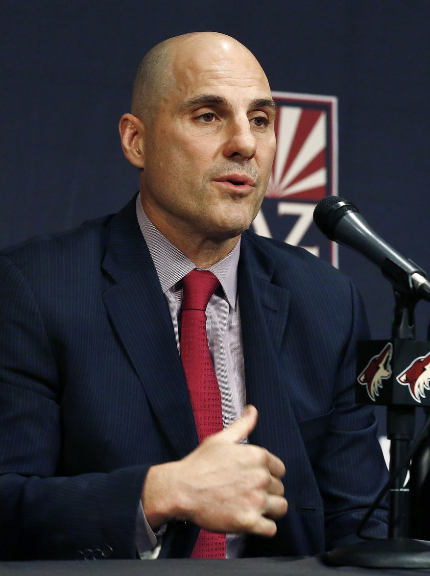 Rick Tocchet, new coach of the Arizona Coyotes, answers a question during a news conference for the NHL hockey team Thursday, July 13, 2017, in Glendale, Ariz. (AP Photo/Ross D. Franklin)