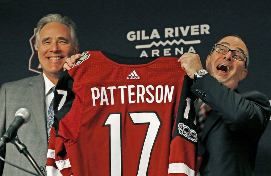 Arizona Coyotes owner Andrew Barroway, right, hams it up as he poses for a photograph with the team's new president and CEO, Steve Patterson during a news conference for the NHL hockey team Thursday, July 13, 2017, in Glendale, Ariz. (AP Photo/Ross D. Franklin)