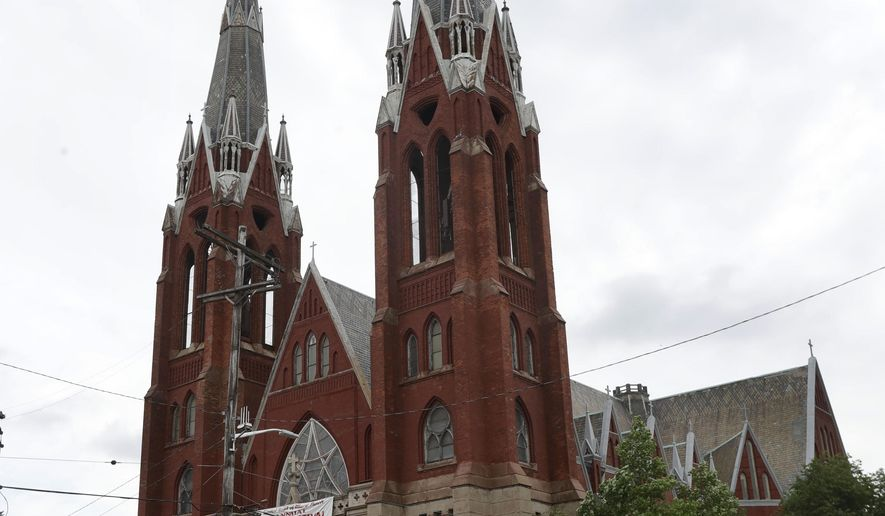 The spires of the Sweetest Heart of Mary Roman Catholic Church are seen, Thursday, July 13, 2017, in Detroit. Members of the church finance council appeared before the Detroit Historic Commission on Wednesday, seeking permission to remove the iconic church's aging spires. Members said the spires were in poor structural condition and at risk of collapsing and said it would cost about $1.3 million to repair them, which the church can't afford, the finance council president said. (AP Photo/Carlos Osorio)